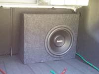 Установка сабвуфера Boston Acoustics G112-4 в Chevrolet Aveo