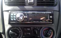 Фотография установки магнитолы Alpine CDE-9880R в Nissan Sunny