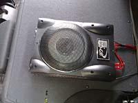 Установка сабвуфера Kicx ALN 200SA в Opel Astra